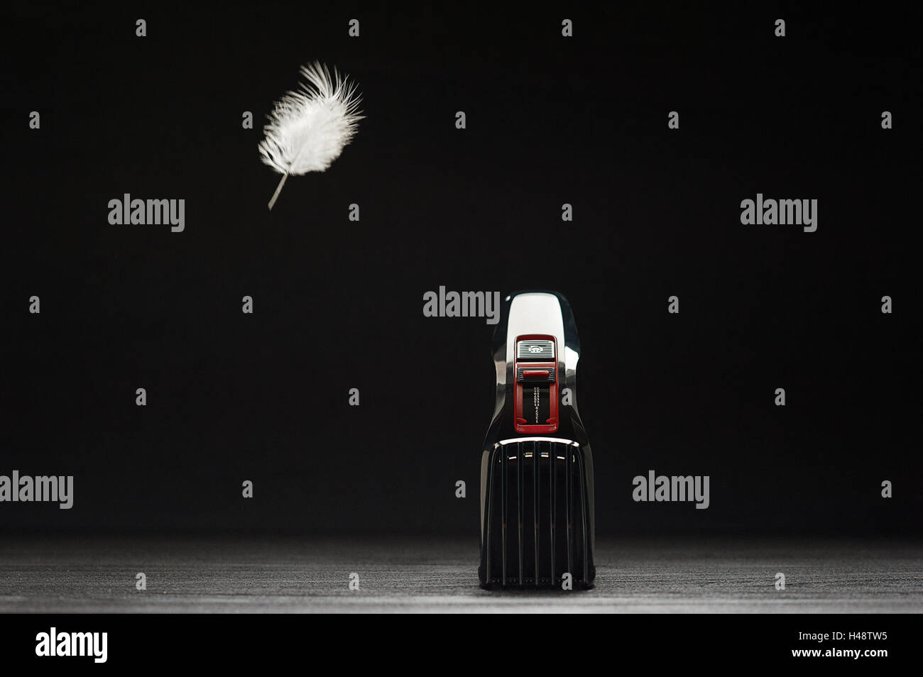 Hair trimmer in front of a black background - Stock Image