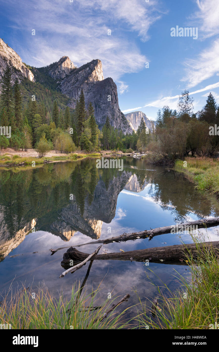 The Three Brothers mountains reflected in the tranquil waters of the River Merced, Yosemite National Park, California, - Stock Image
