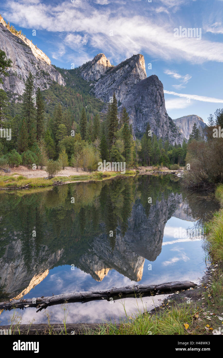 The Three Brothers reflected in the River Merced, Yosemite National Park, California, USA. Autumn (October) 2014. - Stock Image