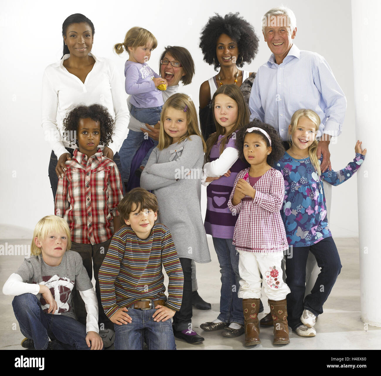 Women, man, children, nationality, passed away, laugh, happy, group picture, model released, people, adults, girls, - Stock Image