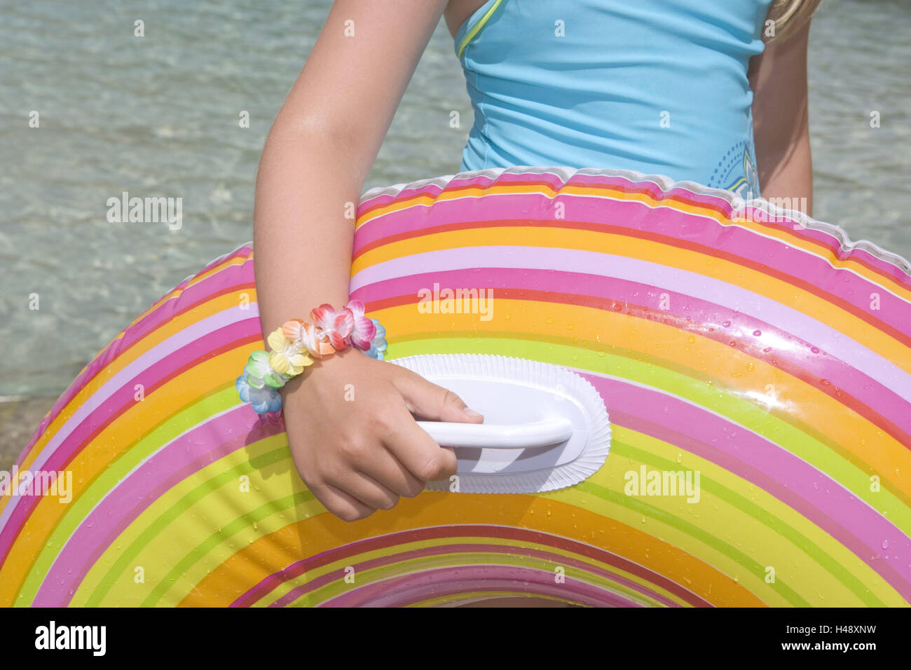 8277657f97692 Girls, swimming ring, water, detail, icon, swim, have of a bath, fun, play,  summers, vacation, holidays, leisure time, sea, bracelet, swimsuit, ...