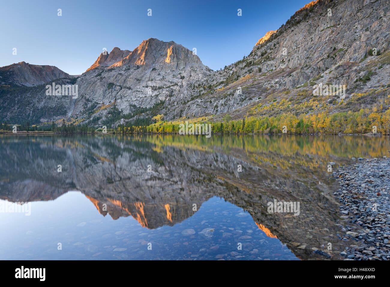 Carson Peak reflected in Silver Lake at dawn, June Lake Loop, California, USA. Autumn (October) 2014. - Stock Image
