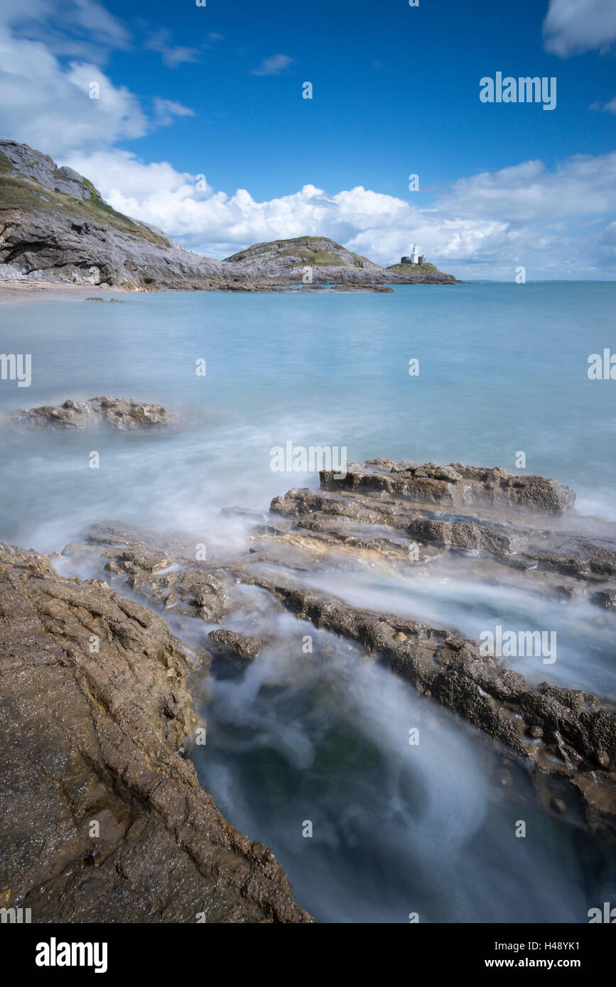 Mumbles lighthouse and Bracelet Bay in the Gower Peninsula, Swansea, Wales. Summer (August) 2014. - Stock Image