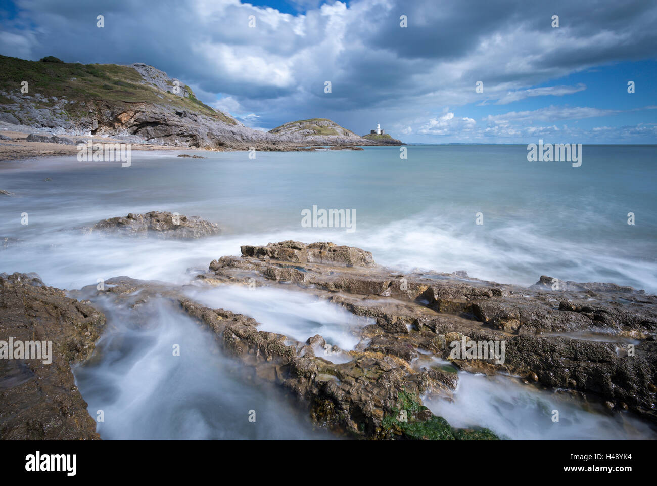 Mumbles lighthouse from Bracelet Bay, Gower Peninsula, Swansea, Wales. Summer (August) 2014. - Stock Image