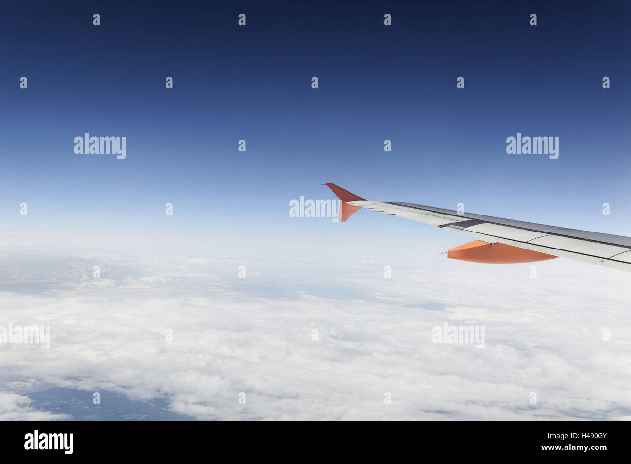Airplane, wing, airbus A320 above the clouds, sky, horizon, - Stock Image