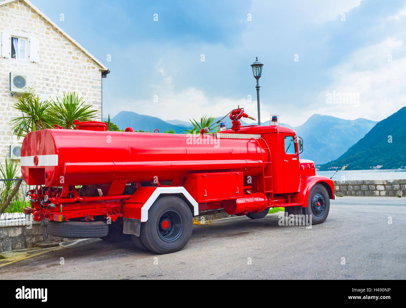 The retro fire truck parked on the promenade of Perast, Montenegro. Stock Photo