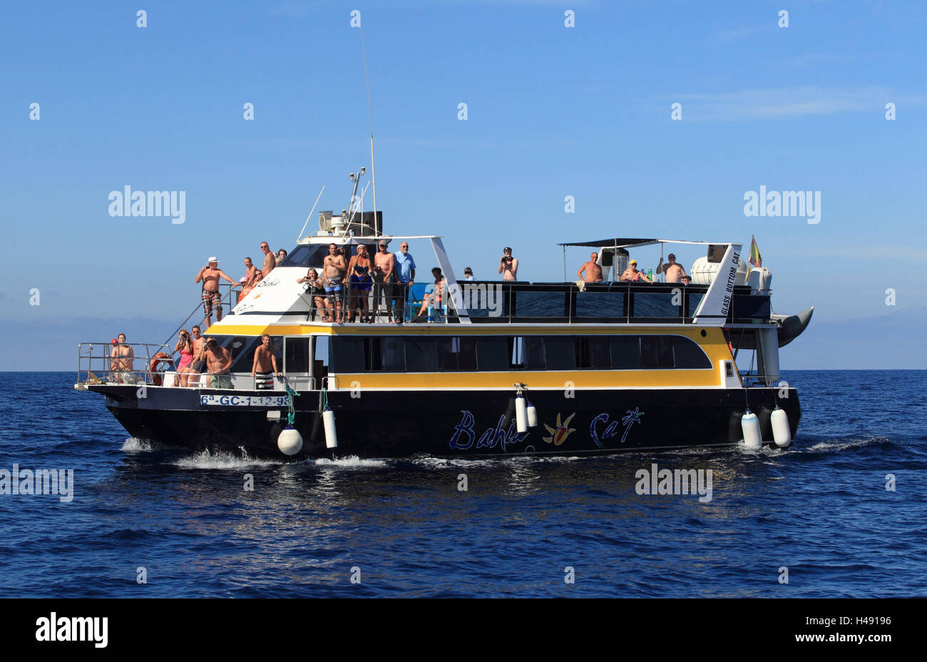 Ship, tourists, whale watching, dolphin watching, - Stock Image