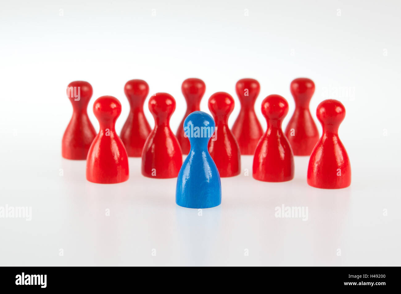 Gaming pieces symbolise team and lead figure, - Stock Image