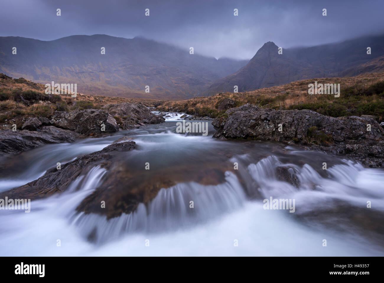 The Fairy Pools beneath the Cuillin Hills mountain range, Isle of Skye, Scotland. Winter (December) 2013. - Stock Image