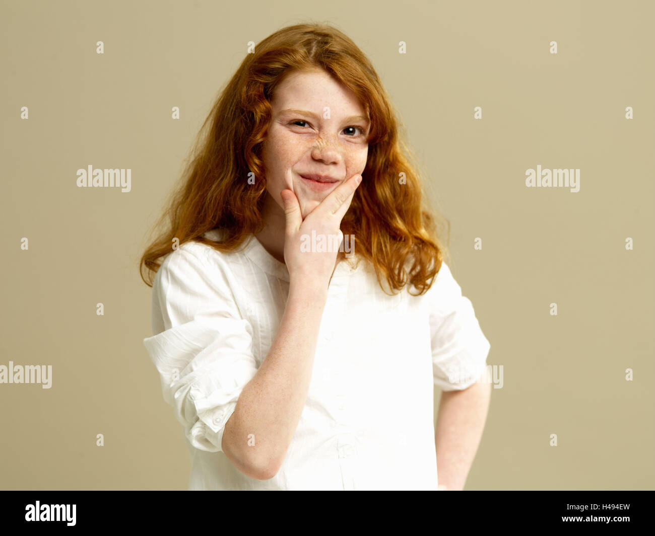 Girls, red-haired, gesture, thoughtfully, portrait, child, long-haired, blouse, shirt, freckles, hand, chin, brood, - Stock Image