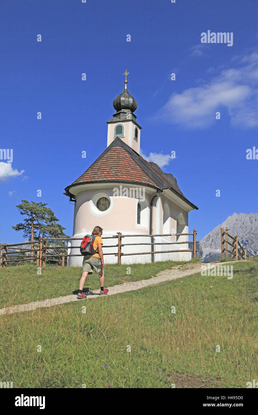 Traveller, mountain chapel, hiker, - Stock Image