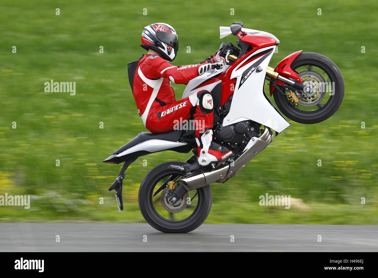 Motorcycle, Honda CBR 600 F, moving, Wheelie, panning, - Stock Image