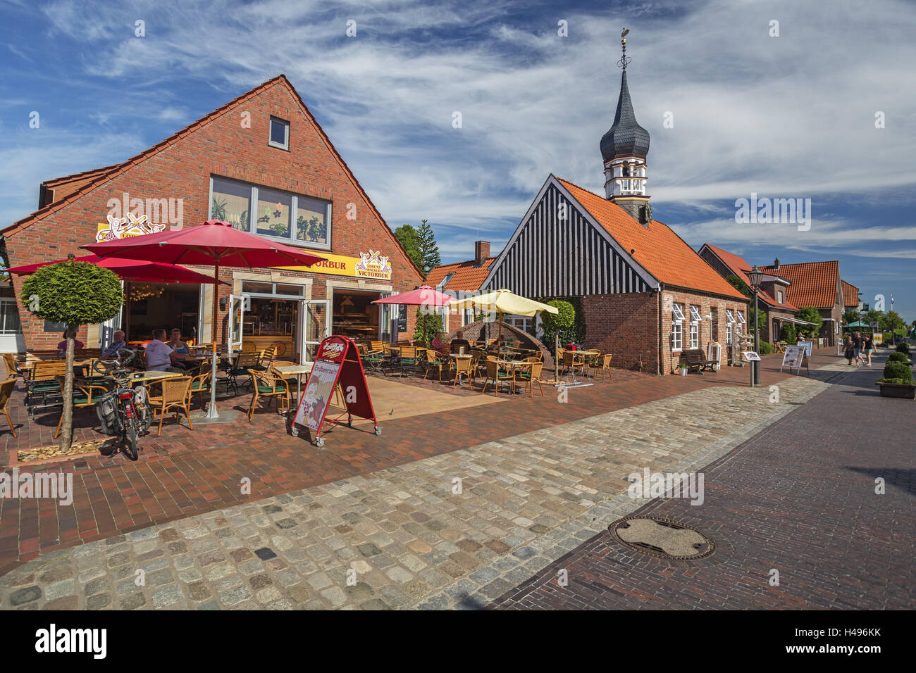 Hooksiel (village) mussel museum at bulbous spire, early artist's house, school, city hall, health resort administration, - Stock Image