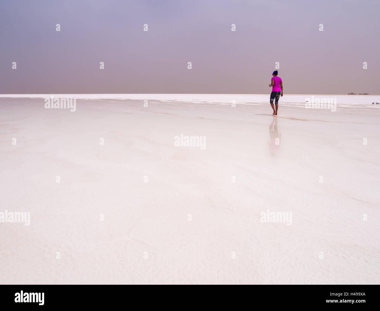 Tourist visiting salt desert and lake in the Afar Region, Danakil Depression, Ethiopia. - Stock Image