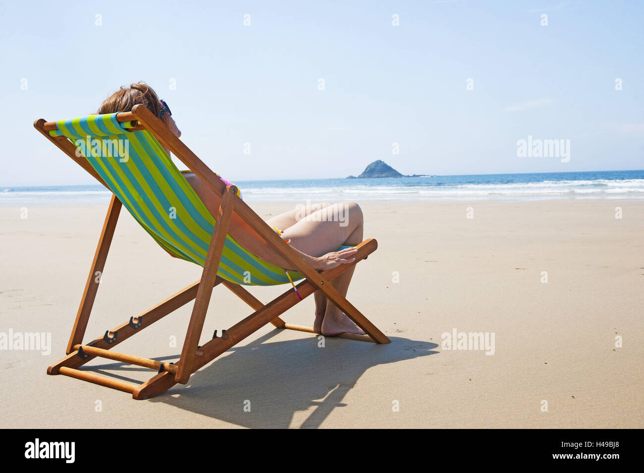 Woman, sunbed, beach, - Stock Image
