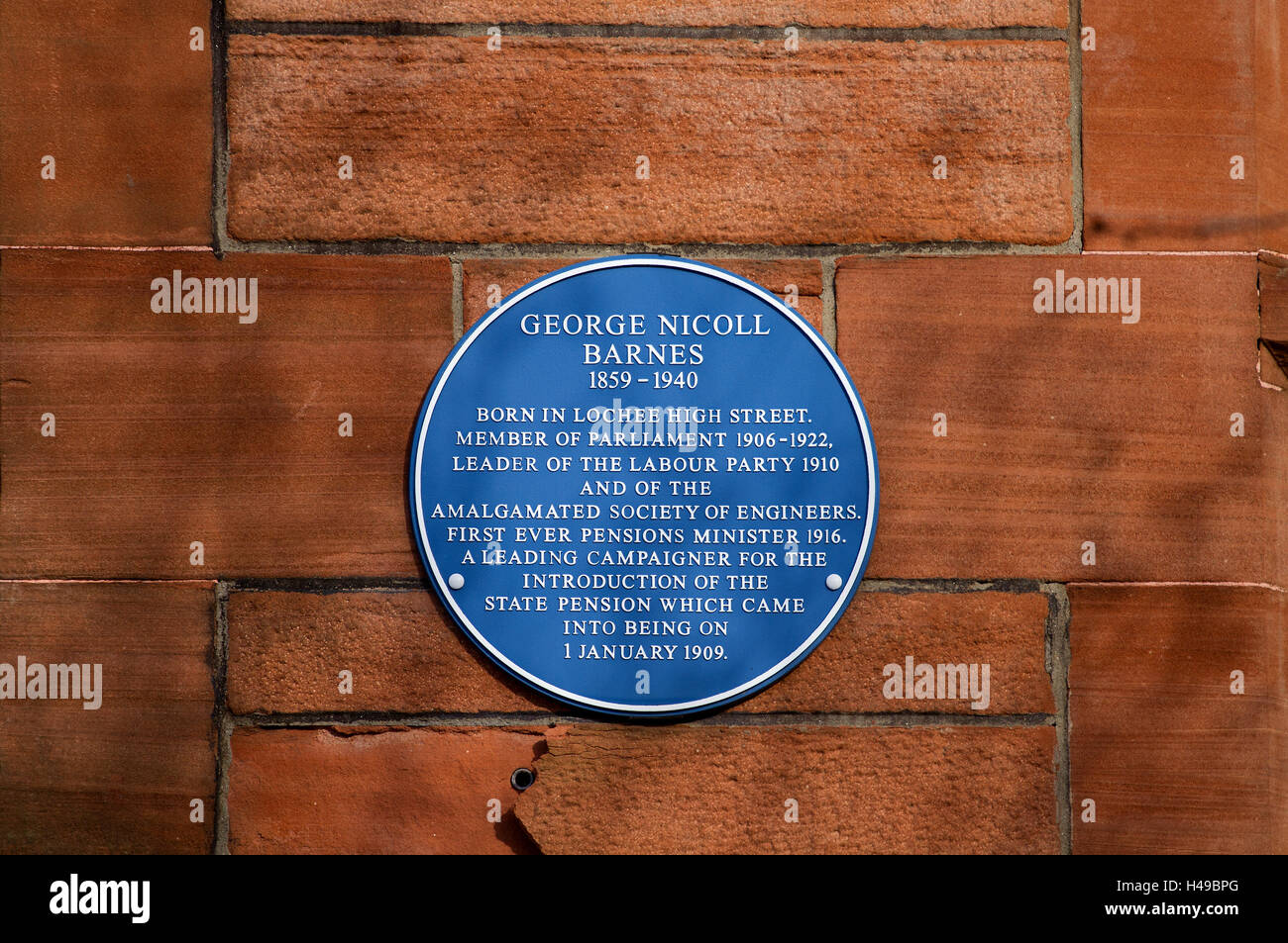 Plaque of politician George Nicoll Barnes on the wall of the 1894 Lochee Public Library and Reading-Room in Dundee.UK - Stock Image
