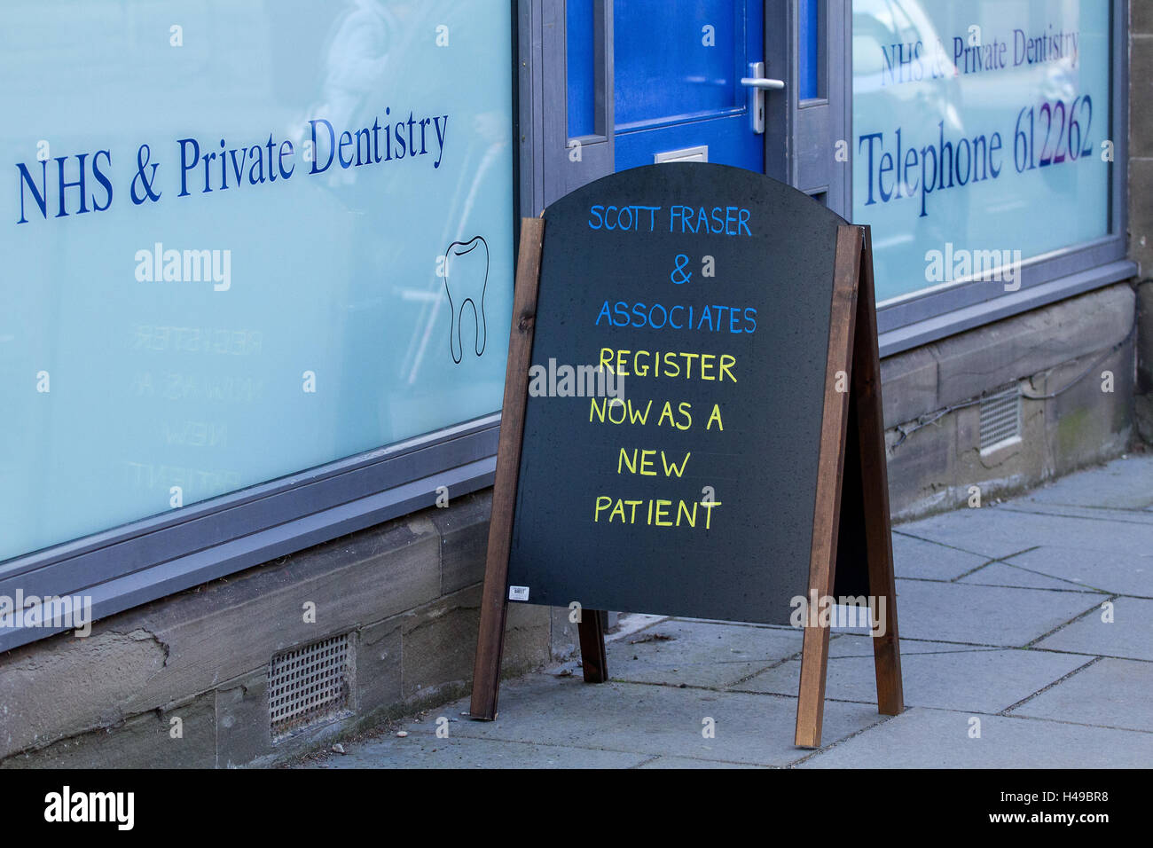 Scott Fraser & Associate Dental Surgery NHS is a Private Dental Surgery located at 48 High St Lochee in Dundee, - Stock Image