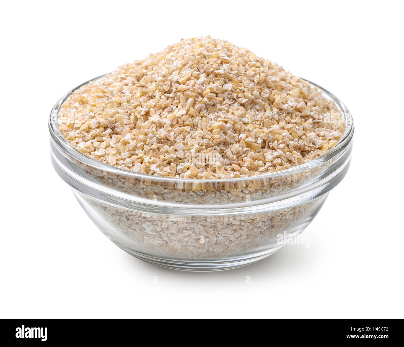 Glass bowl of barley grits isolated on white - Stock Image