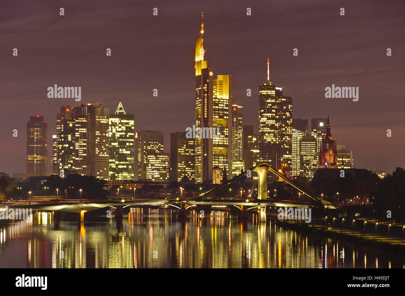 Germany, Hessen, Frankfurt, Main, Skyline, Evening, Dusk, Dawn, Architecture, Banking, Bank towers, lights, bridge, - Stock Image