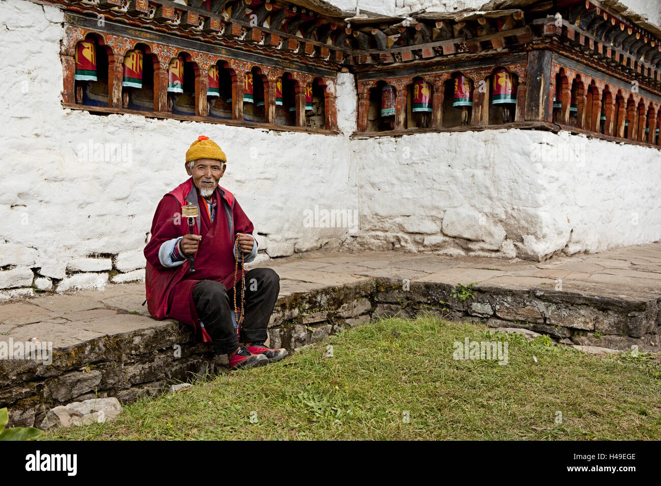 Kingdom Bhutan, Buddhist with prayer mill, - Stock Image
