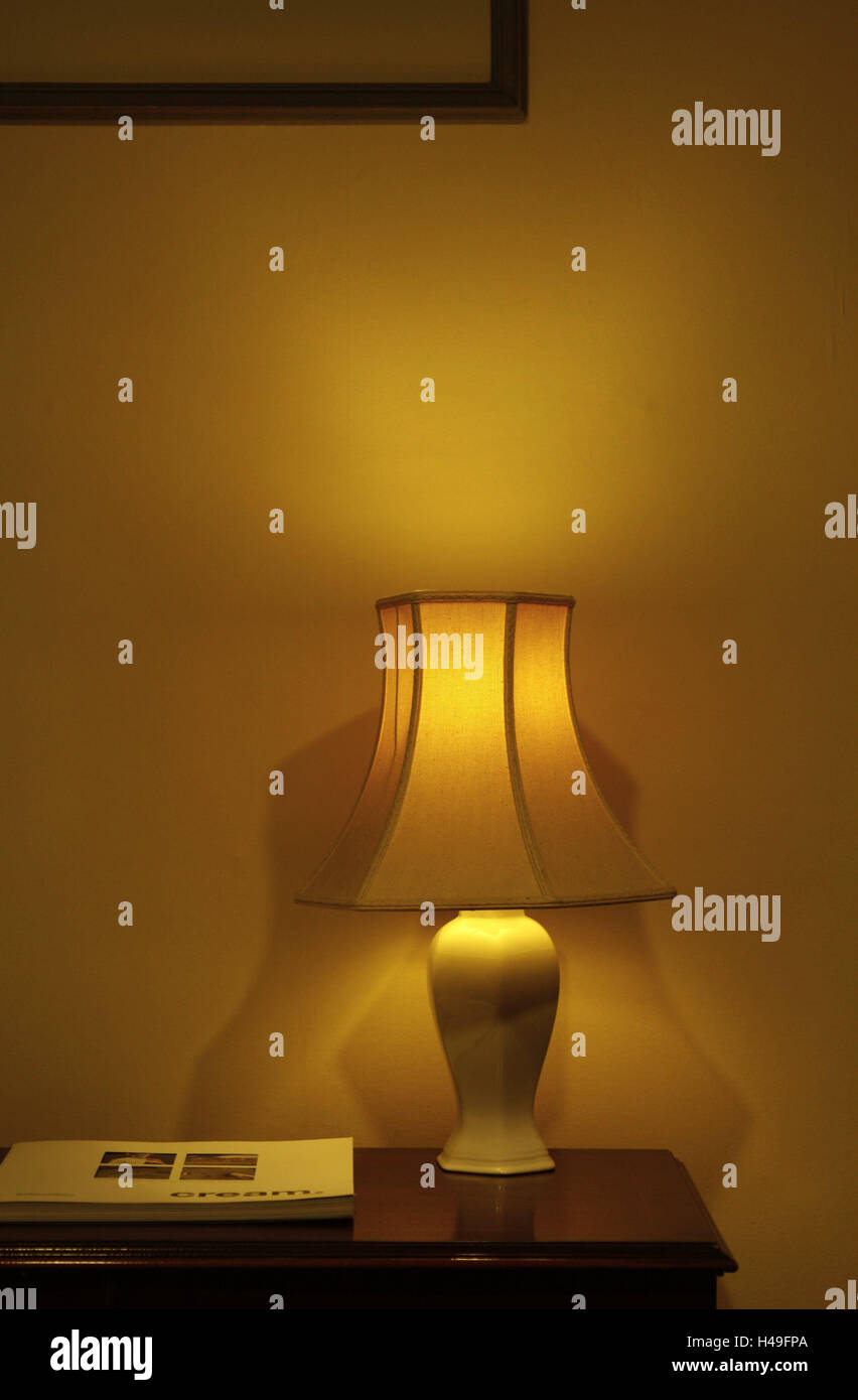 Living space, chest drawers, lamp, light, in, flat, cupboard, clipboard, lampshade, table headlight, shine, wall, - Stock Image
