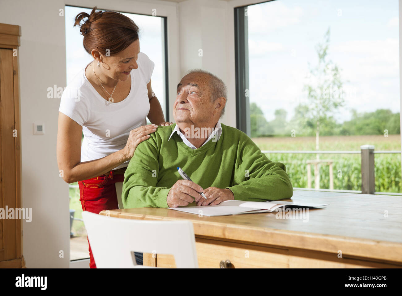 Senior man looks after advance decision, - Stock Image
