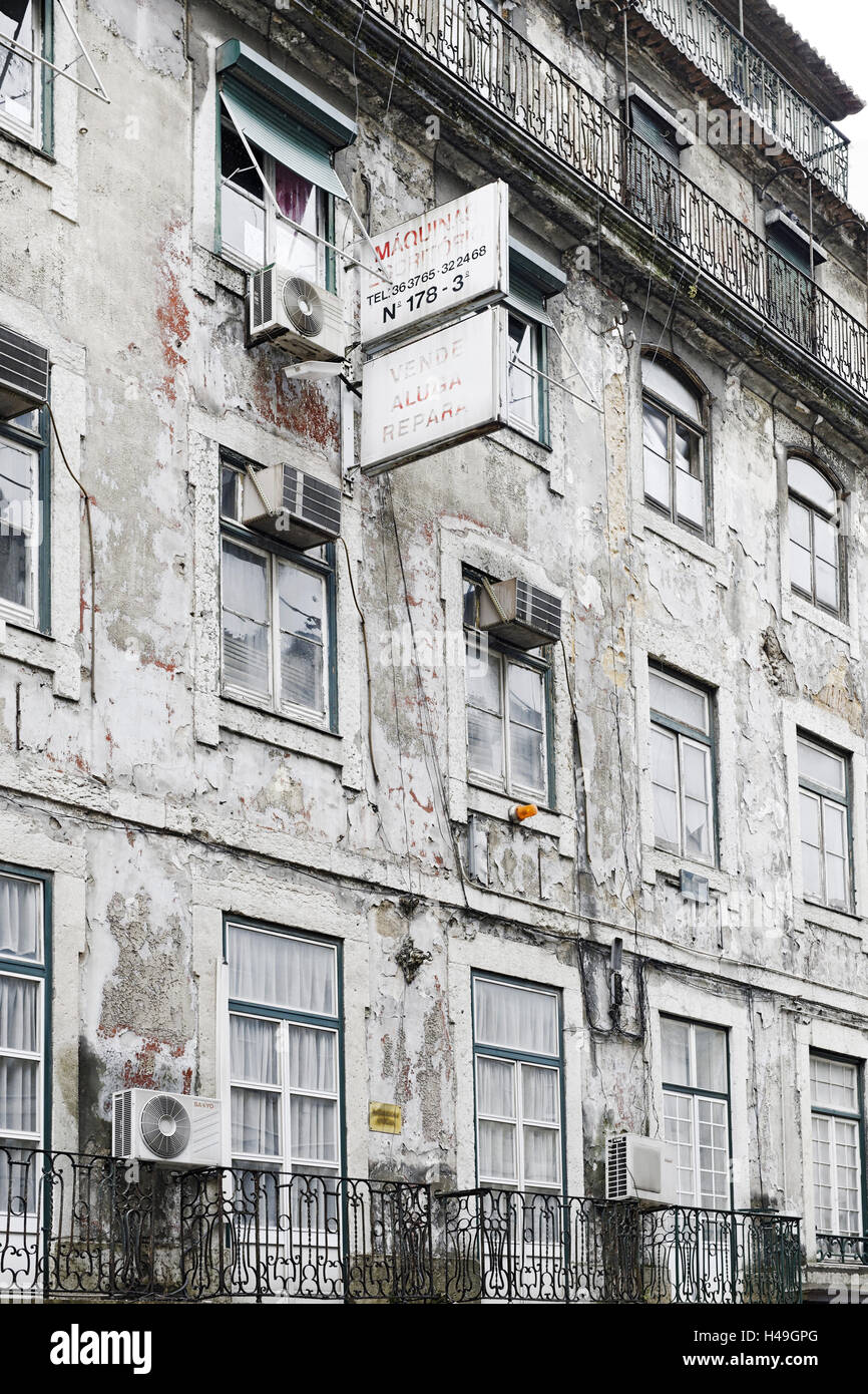 Ramshackle apartment building with alarm system, Baixa district, Lisbon, Portugal, - Stock Image