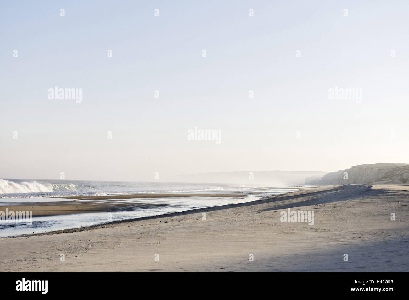 Gentle light at sunrise, surf, Portuguese Atlantic coast, Praia d'el Rey, province Obidos, Portugal, - Stock Image