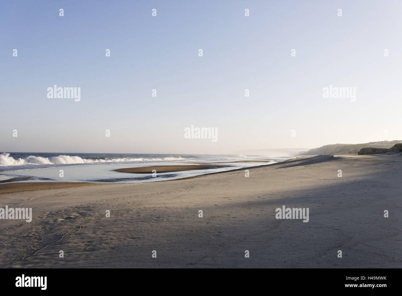 Gentle light at sunrise, surf, Portuguese Atlantic coast, Praia d'el Rey, province Obidos, Portugal, - Stock Image