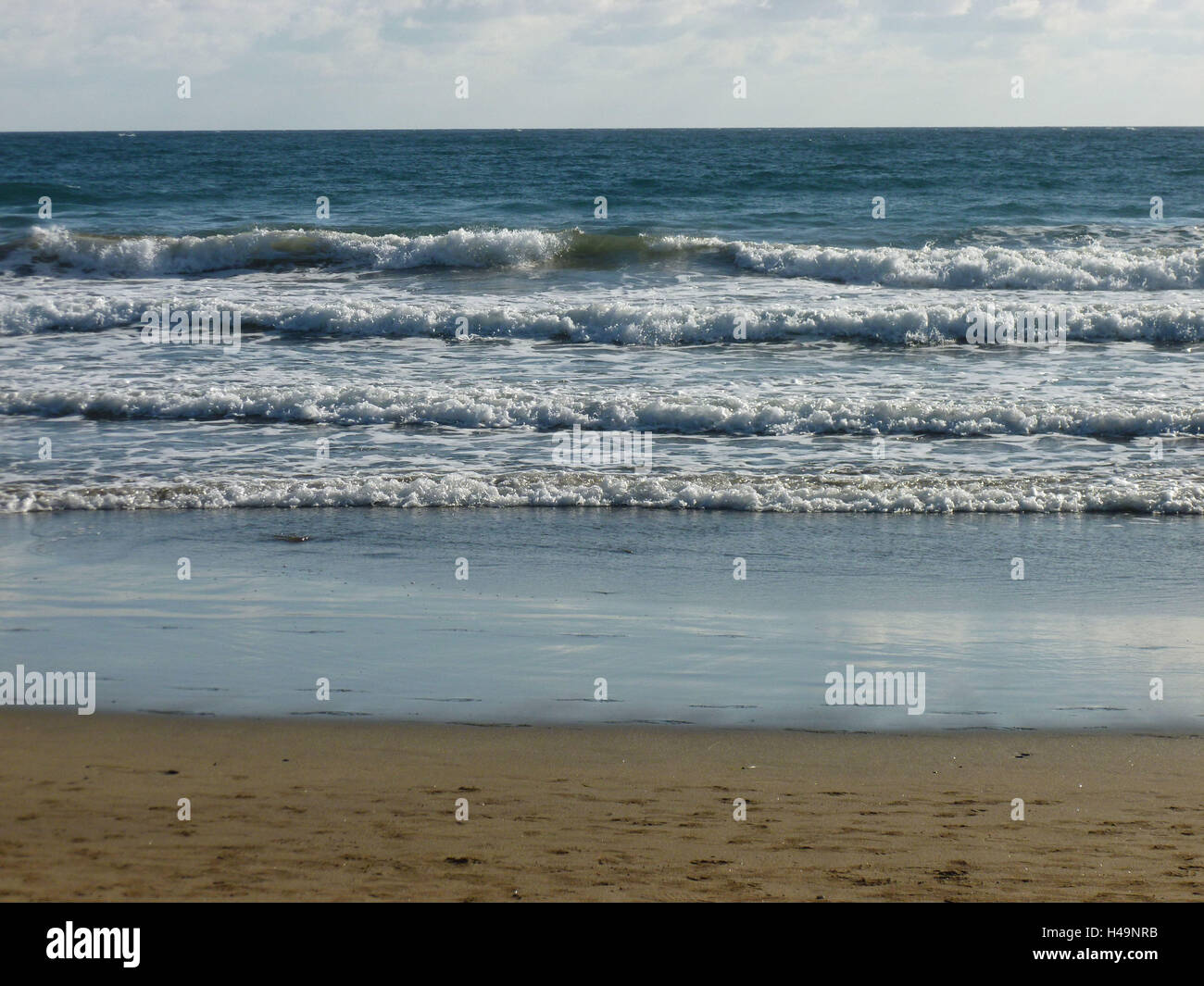 Grain Canaria, Atlantic coast, gentle waves in the sandy beach Playa Maspalomas, - Stock Image