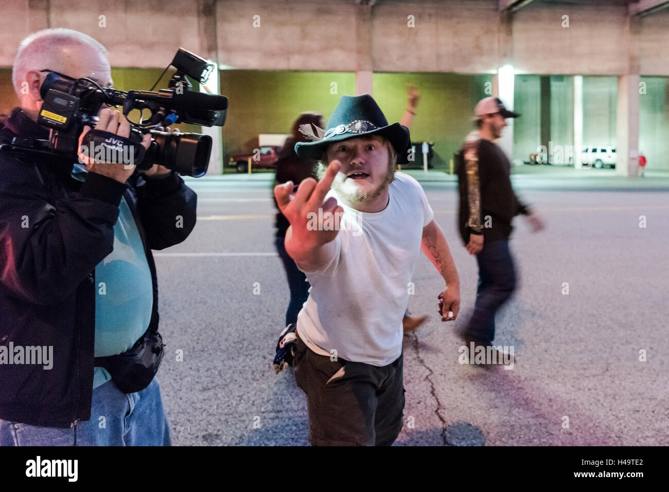 Cincinnati, OH, USA. 13th October, 2016. A trump supporter shows me the middle finger for photographing the event. - Stock Image