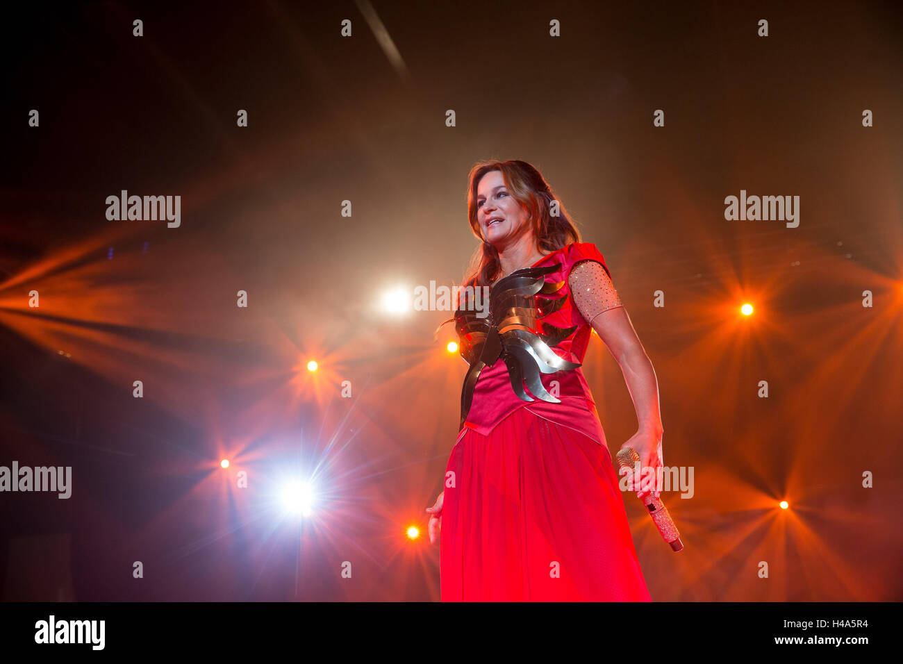 German hit singer Andrea Berg stands on stage during her concert 'Seelenleben' (lit. 'soul life') in Krefeld, Germany, Stock Photo