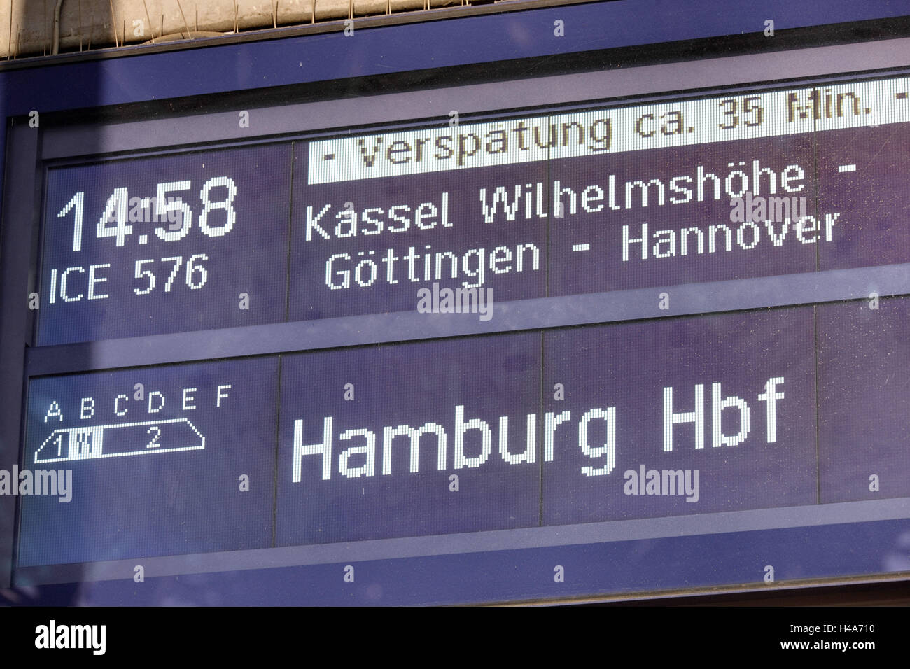 Railway station, destination board, delay, - Stock Image