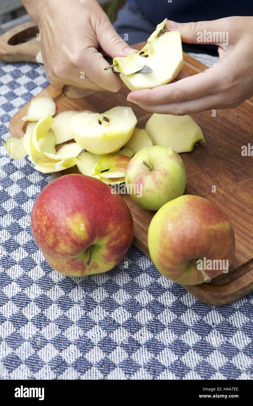 Woman, apple, core, medium close-up, - Stock Image