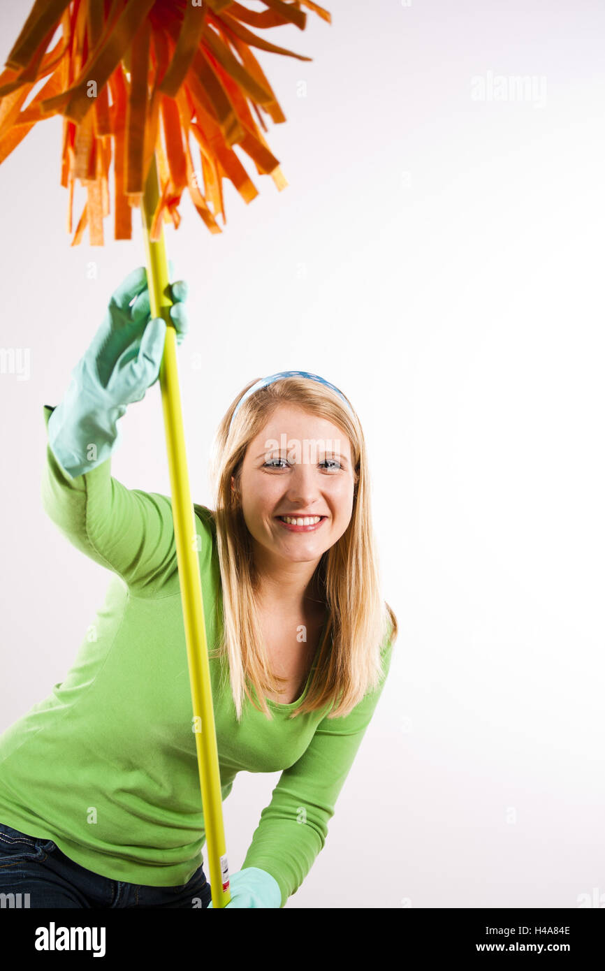 Young woman with wiping mop, happily, half portrait, - Stock Image