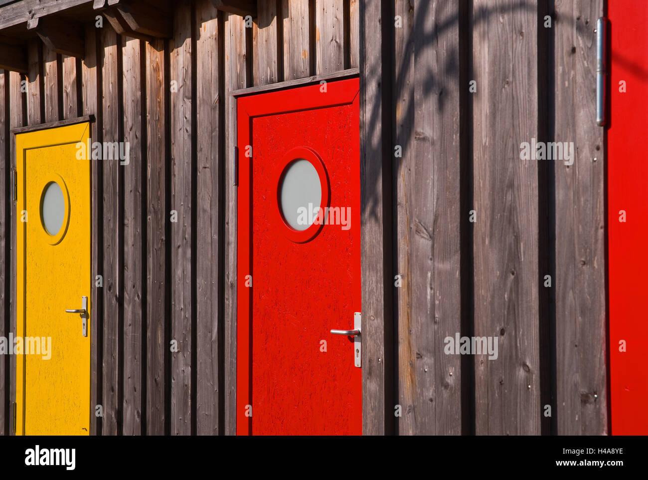 wooden steelworks, coloured doors, - Stock Image