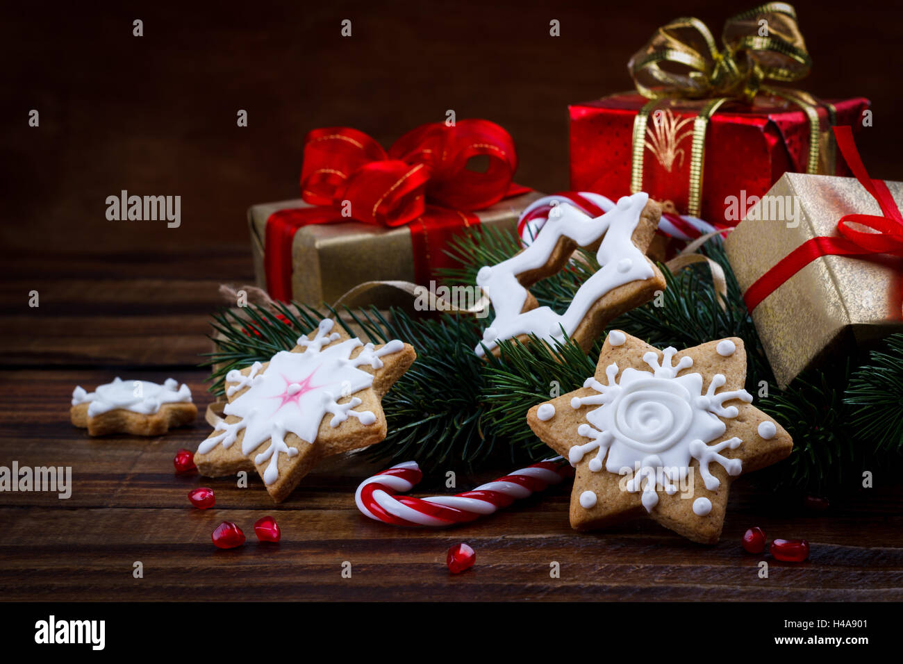Christmas decoration composition with cookies gift box and pomegranate seeds - Stock Image