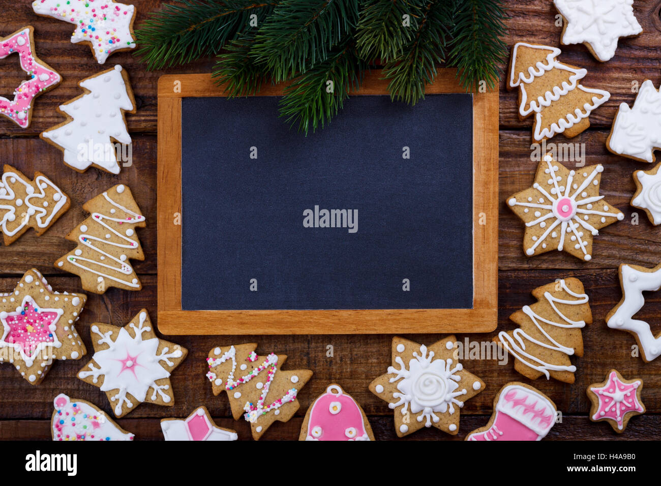 Christmas cookies and vintage black board for text. Holiday background - Stock Image
