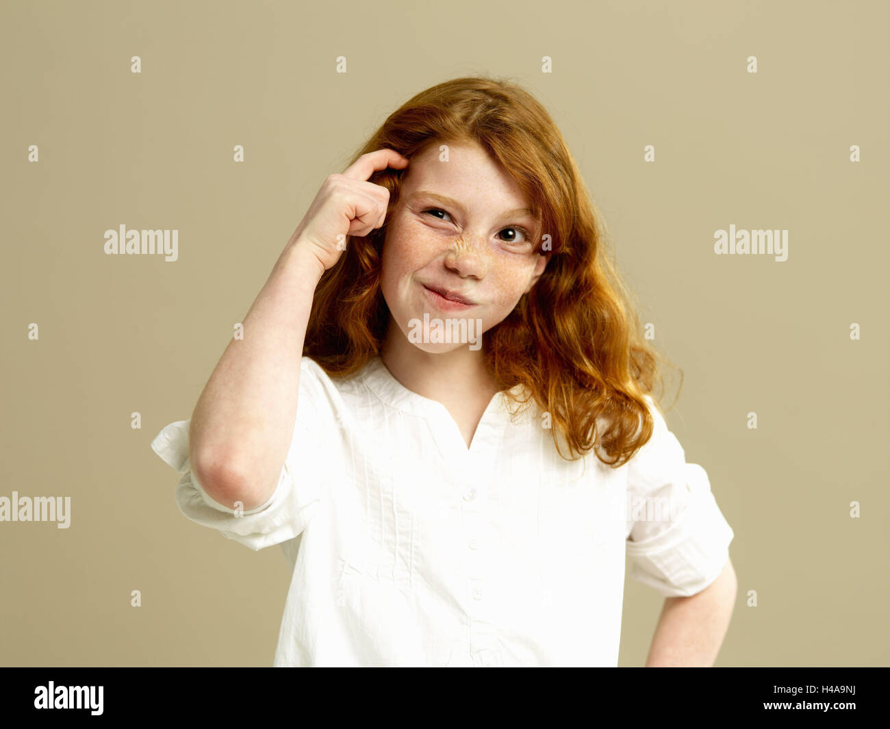 Girls, red-haired, gesture, thoughtfully, portrait, child, long-haired, blouse, shirt, freckles, brood, doubt undecided, - Stock Image