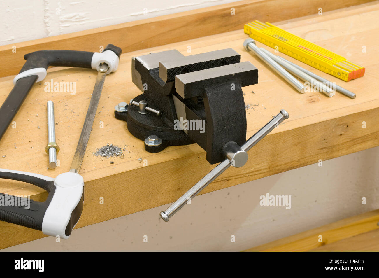 Anvil, workbench, saw, steel vice - Stock Image