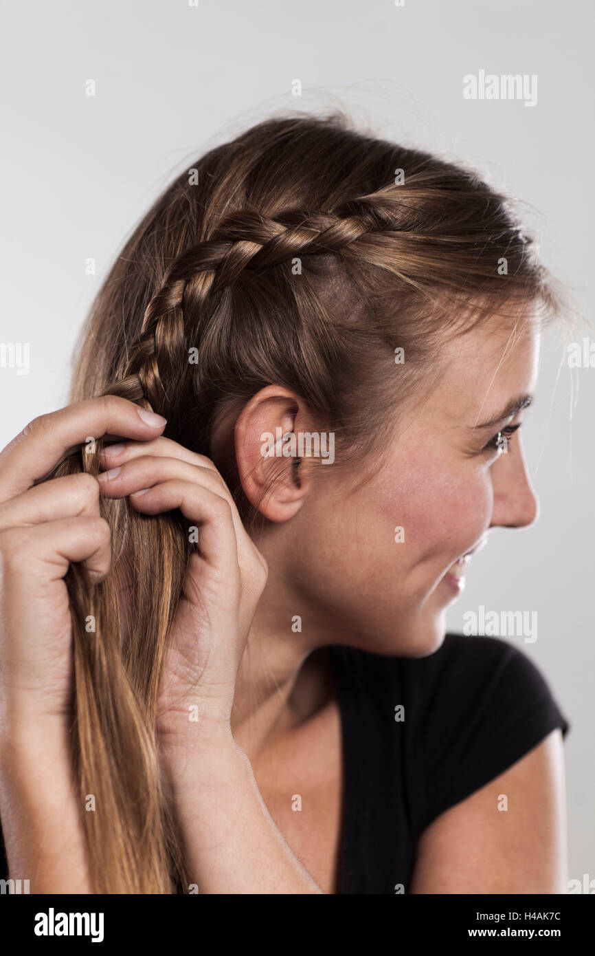 Instructions braided hairstyle with bun step 2 of 3 Stock Photo ...