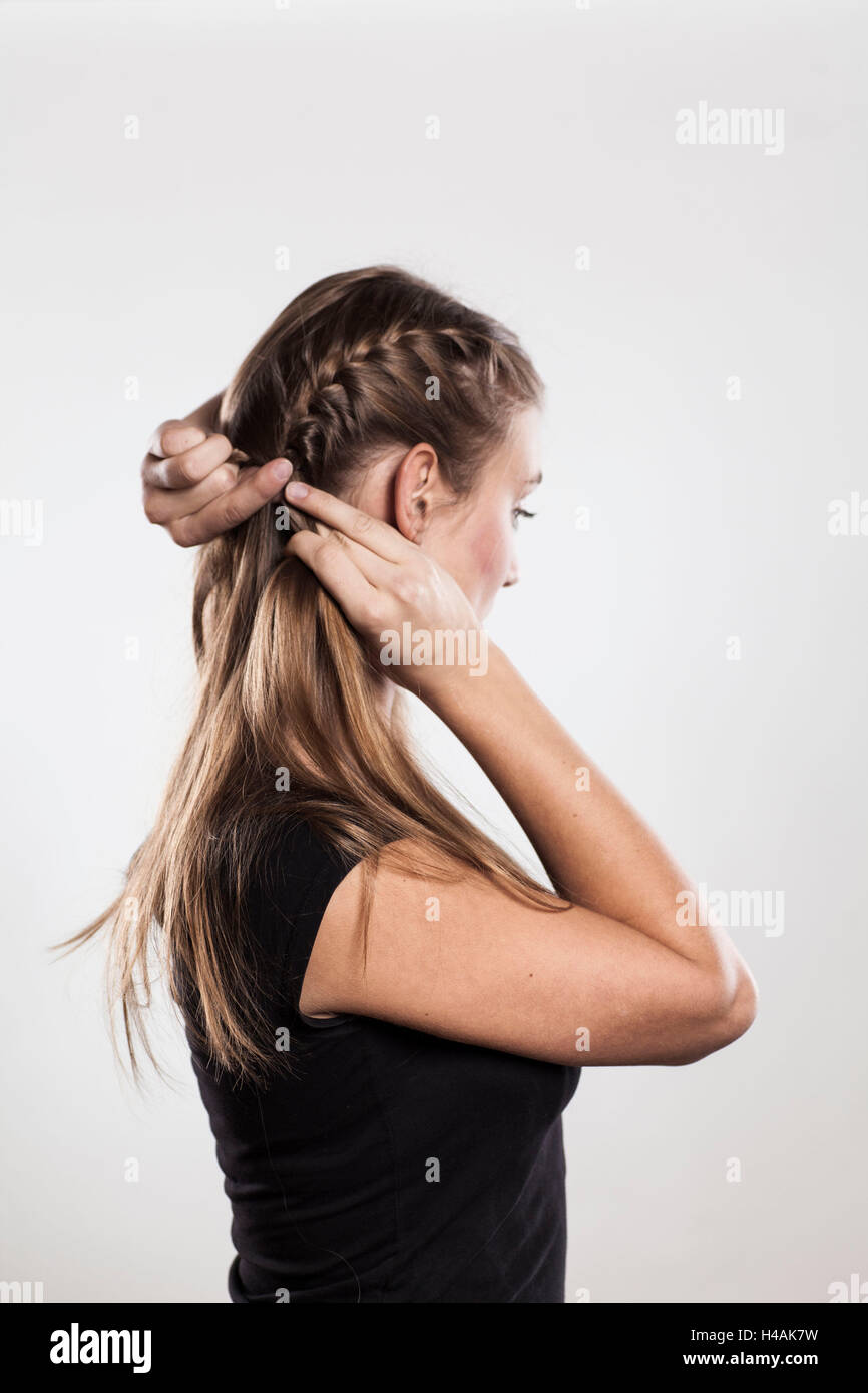 """Instruction:  braided plaits, two """"Gretchen"""" braids, Step 2 from 3 Stock Photo"""