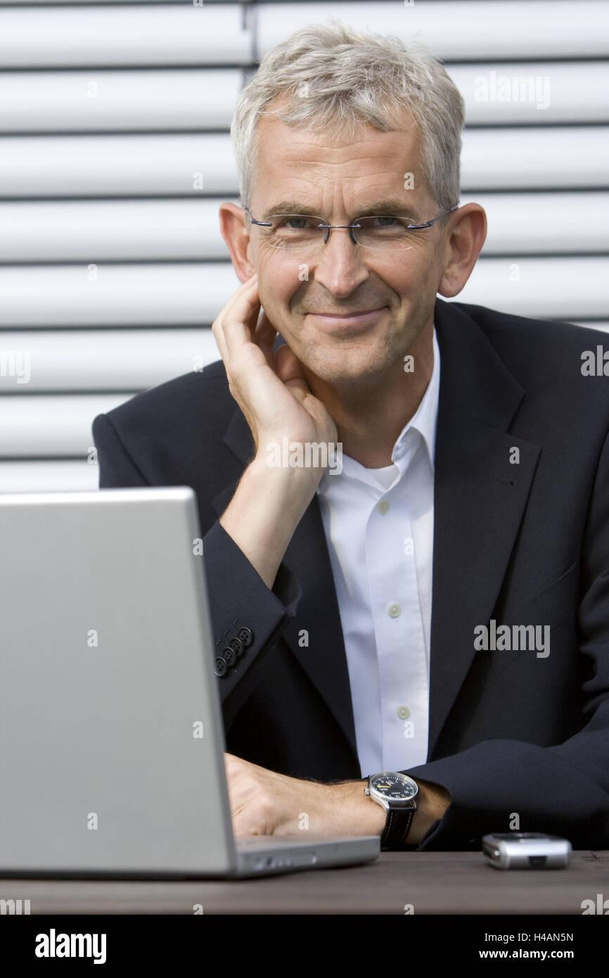 Businessman, notebook computer, smile, portrait, person, man, manager, computer, Internet, Internet surfing, data Stock Photo