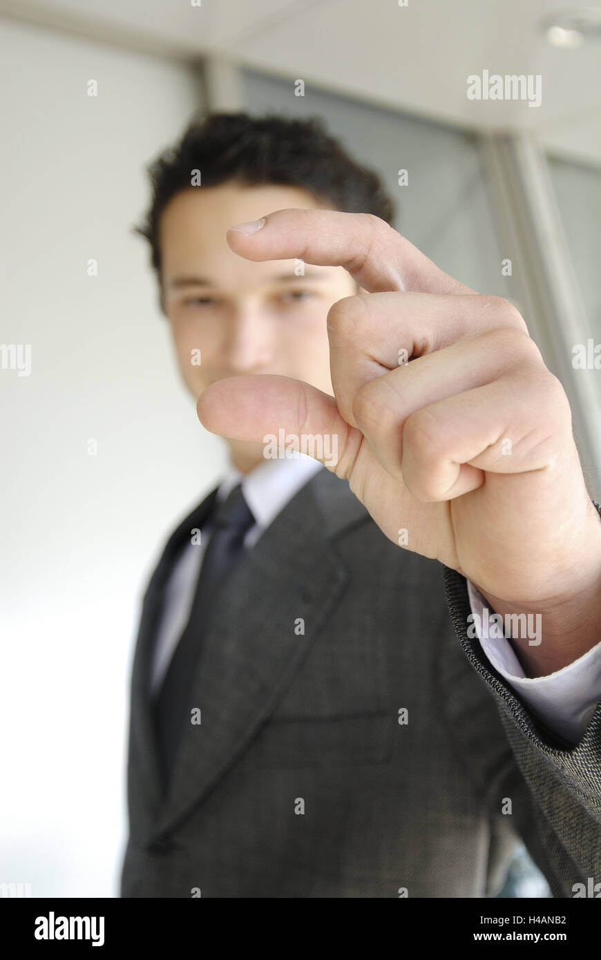 Man, young, stand, gesture, dimensional information, - Stock Image