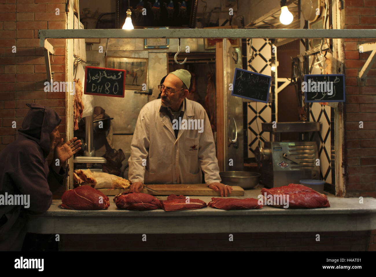 Africa, Morocco, Meknes, Medina, Souk, meat seller behind his stall, - Stock Image