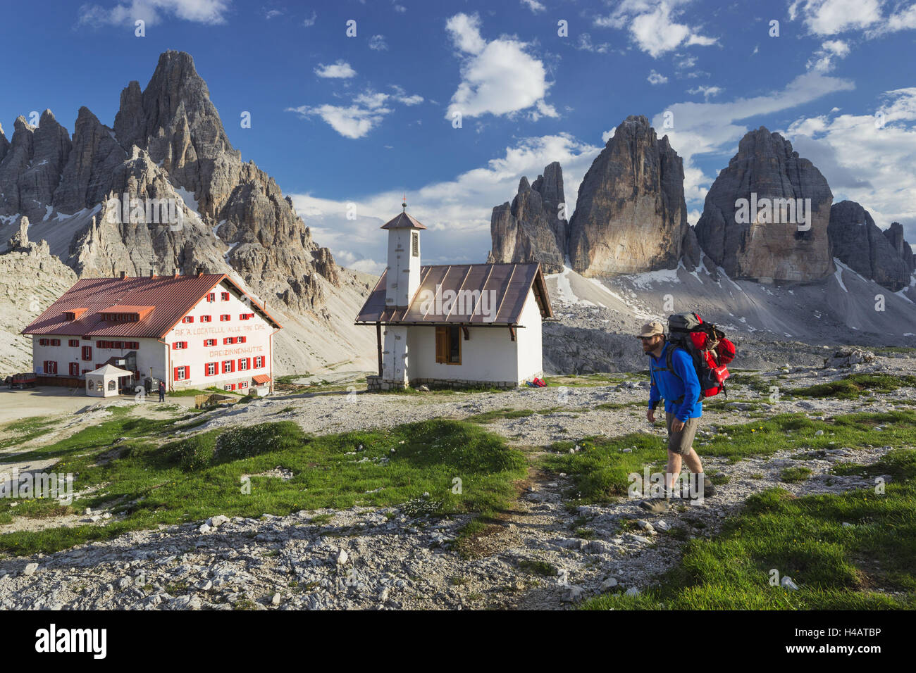 Traveller, chapel, 'Drei Zinnen Hütte' mountain hut, Paternkofel, South Tyrol, the Dolomites mountains, - Stock Image