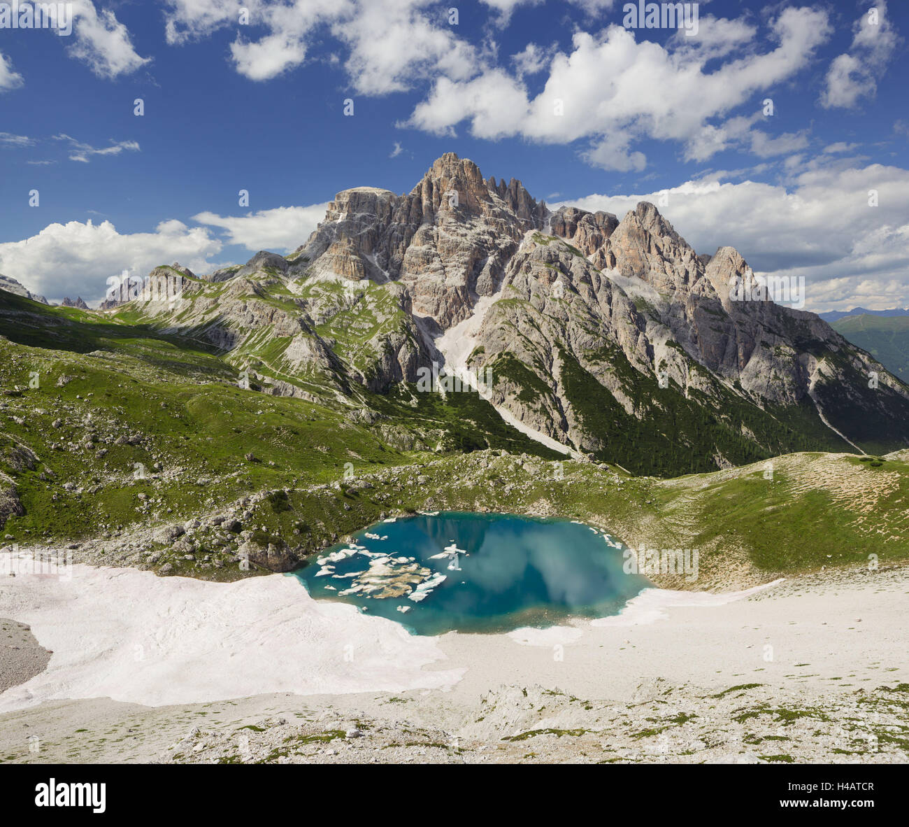 Neunerkofel, snowfield, ice lake, South Tirol, the Dolomites mountains, Italy - Stock Image