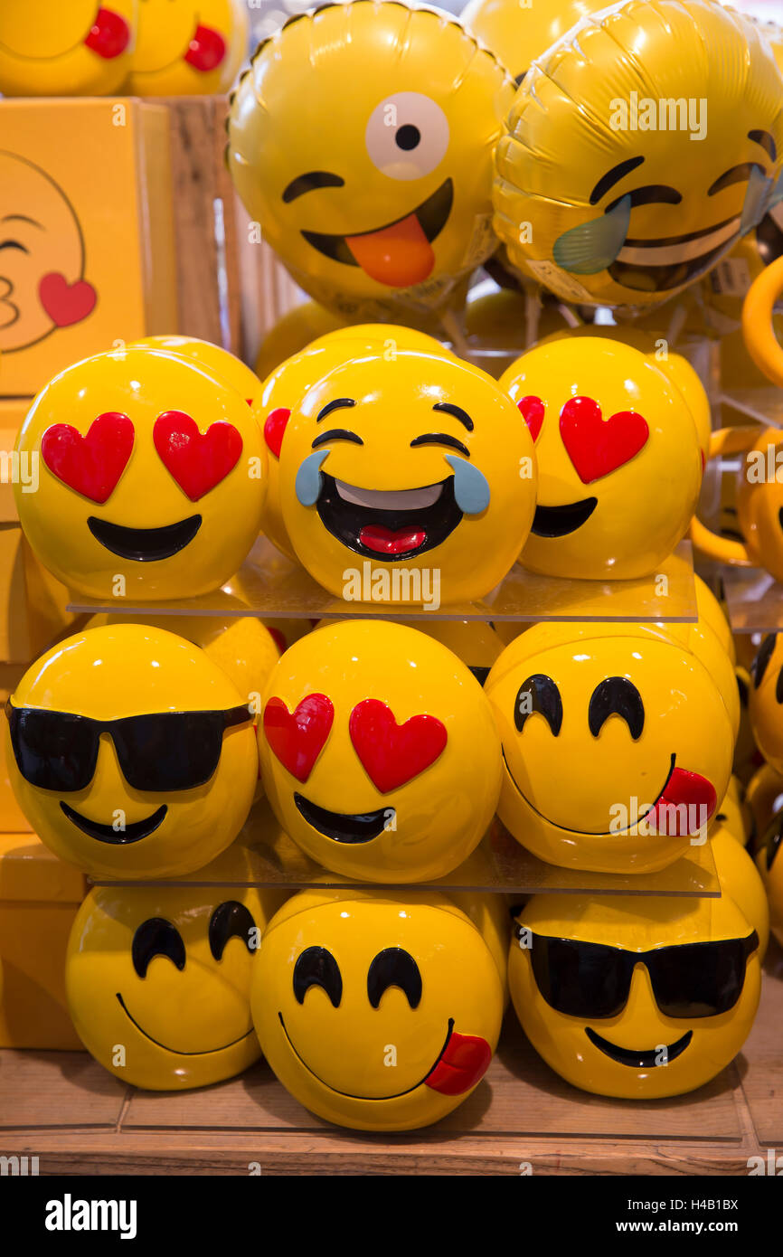 Emoji cups and balloons in a shop in Aachen Germany - Stock Image