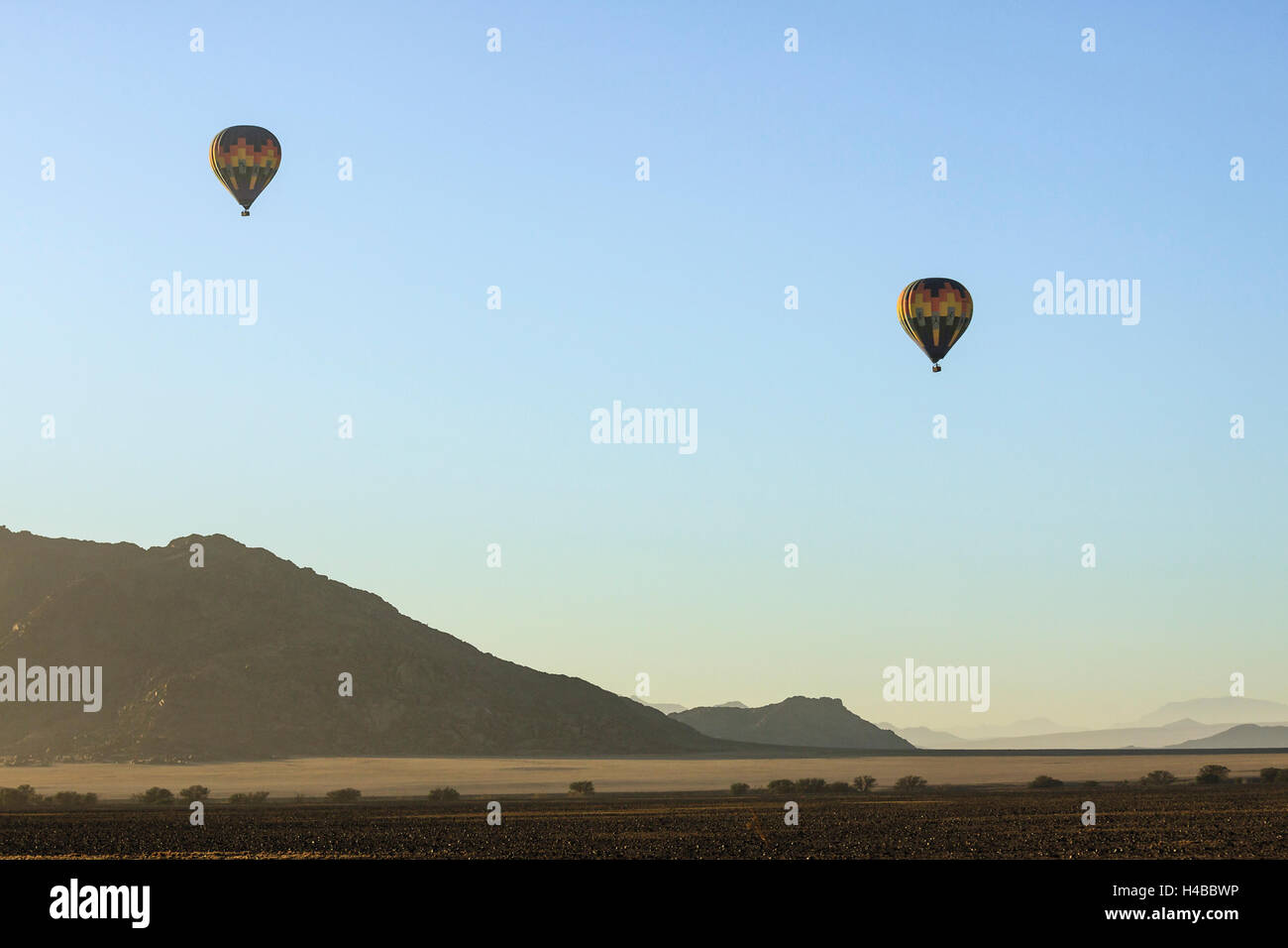 Two hot air balloons flying over the Namib Desert, Sossusvlei, Namibia - Stock Image