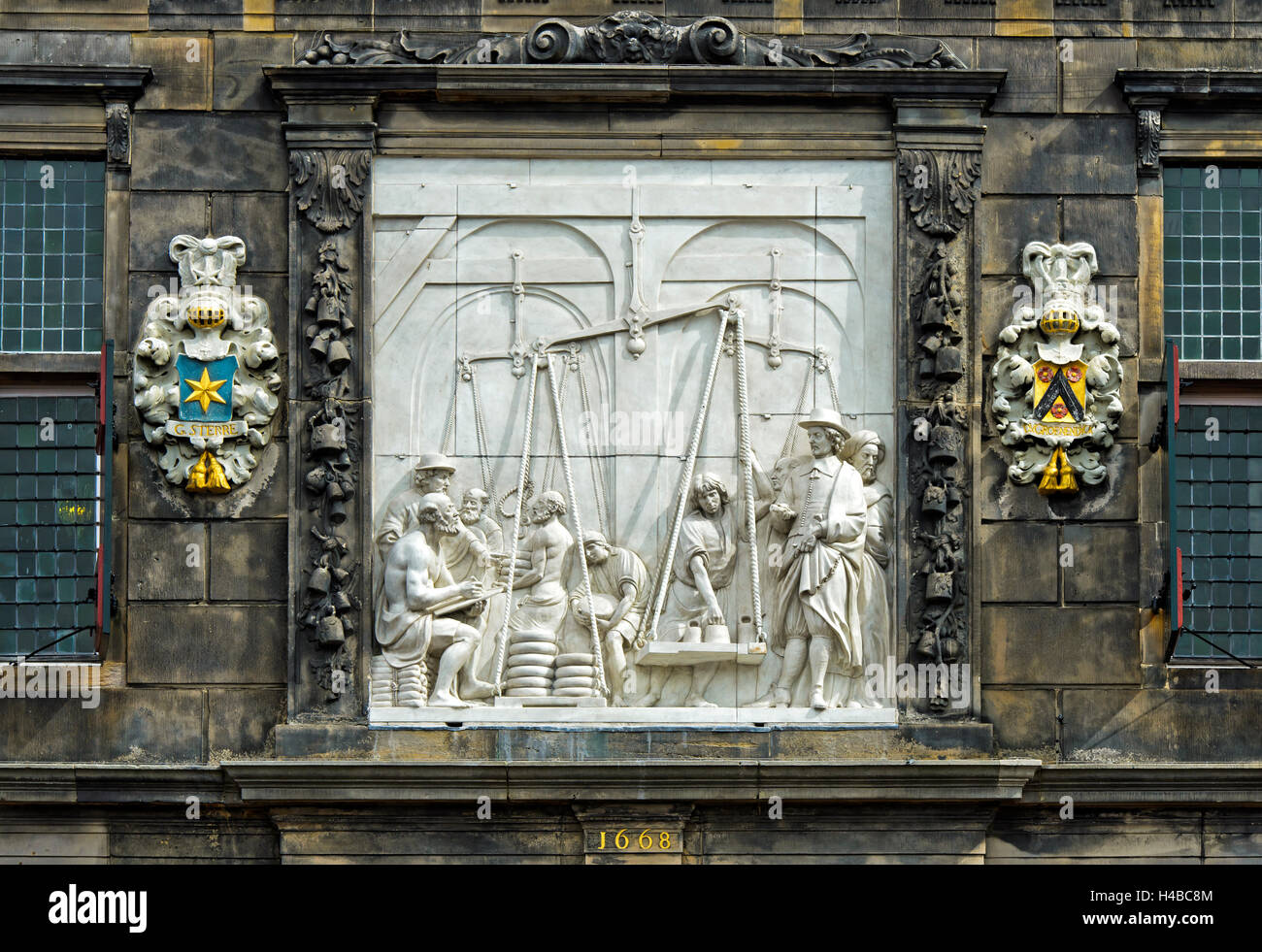 Waaghaus relief depicting weighing of cheese in ancient times, Goudse Waag, Gouda, The Netherlands - Stock Image